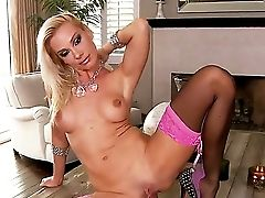 Sandy Wears Sexy Stockings And Gives A Very Dirty Look While She Thrusts That Black Faux-cock Deep Into Her Majestic Bald Cunt.