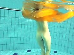 Skinny Hussy Dives Around The Pool With Her Tits And Her Coochie Out